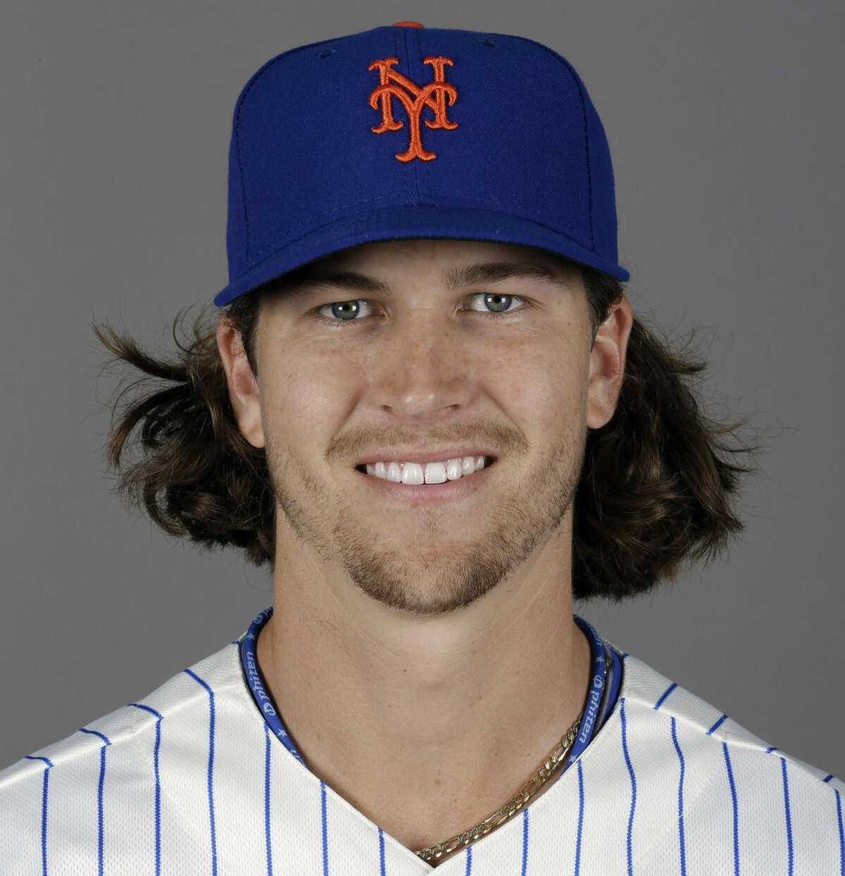 FILE - This is a 2014, file photo showing pitcher Jacob deGrom of the New York Mets baseball team. It's postseason awards time in baseball, starting with the Rookies of the Year. DeGrom has been voted NL Rookie of the Year the Baseball Writers' Association of America announced Monday, Nov. 10, 2014. (AP Photo/Jeff Roberson, File)