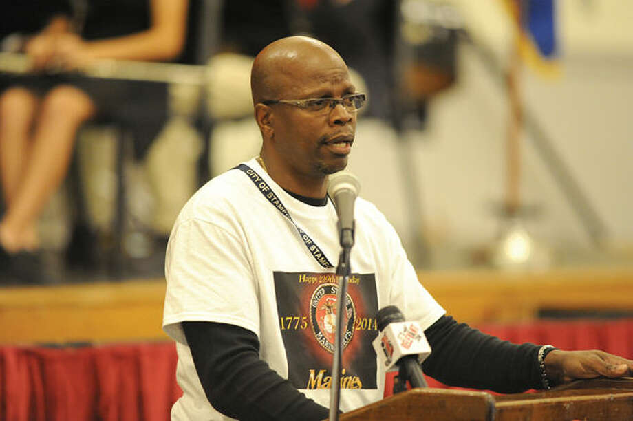 James Jordan Stamford High School security and Operation Desert Storm Marin veteran speaks Monday at the Stamford High School History and Music Department event presenting a Veterans Day assembly to recognize and honor veterans who have proudly served our country. Photo/Matthew Vinci