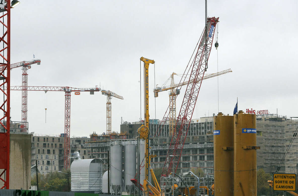 Cranes stand at a building site in Paris, France, Friday Nov. 14 2014. Fears that the 18-country eurozone could be heading back into recession eased Friday with the news that it grew faster than expected in the third quarter, thanks to a better performance by France and confirmation Greece has come out of one of the developed world's deepest recessions in living memory. (AP Photo/Jacques Brinon)