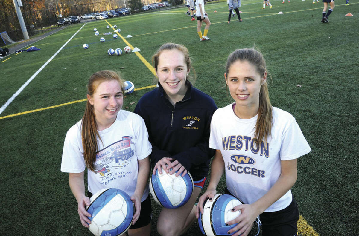 Hour photo/Matthew Vinci The captains of the Weston girls soccer squad, from left to right, Haley Singer, Alexa Werner and Madison Murray.