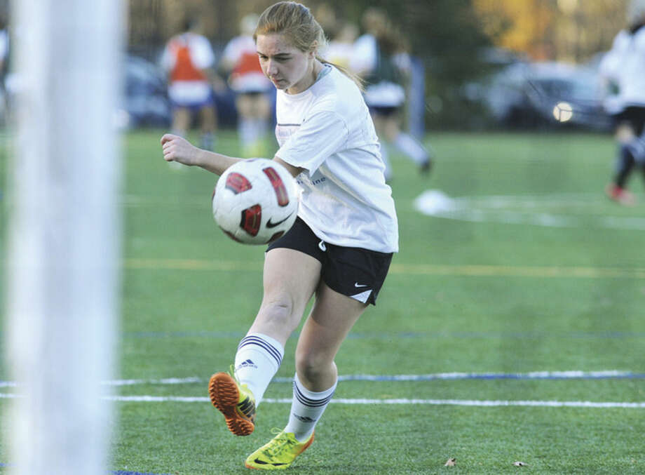 Hour photo/Matthew VinciWeston forward and captain Haley Singer takes a shot on goal during practice Monday afternoon.