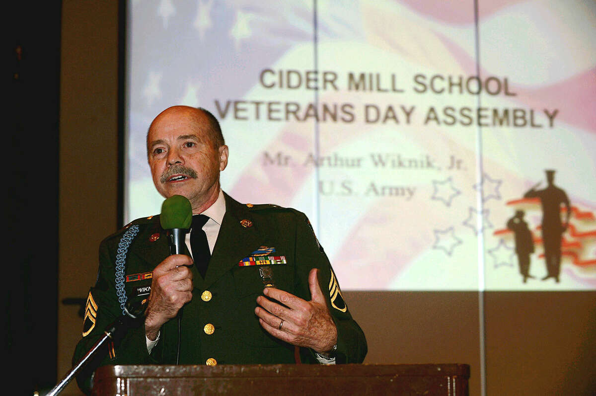 Hour photo/Erik Trautmann Wilton celebrates Veterans Day at Cider Mill School on Tuesday.