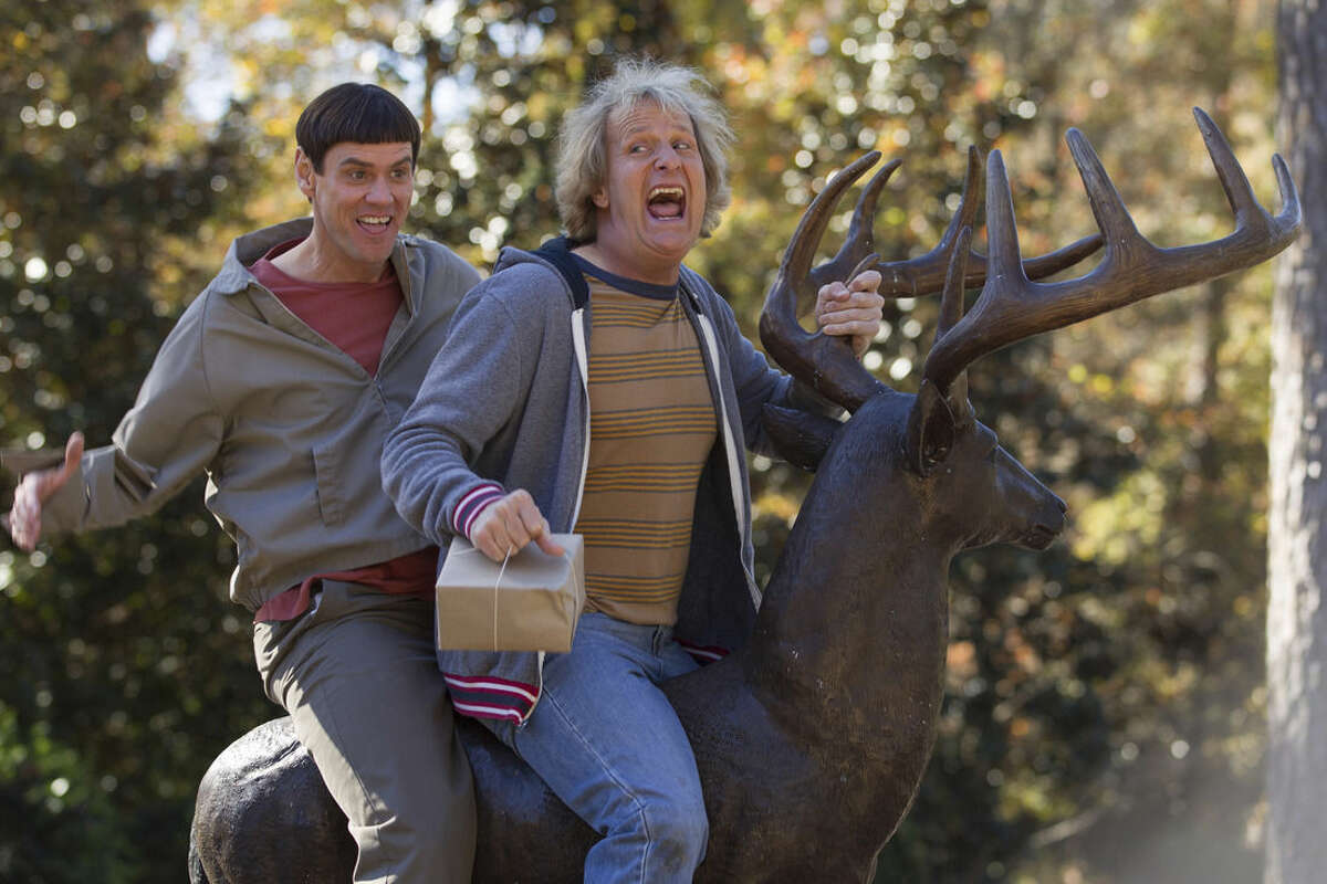 This image released by Universal Pictures shows Jim Carrey, left, and Jeff Daniels in a scene from