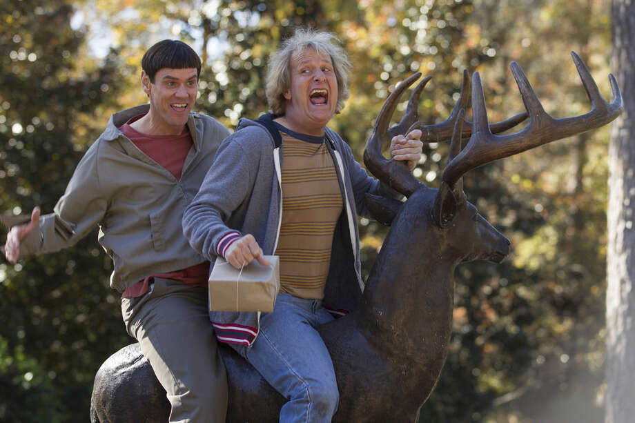 "This image released by Universal Pictures shows Jim Carrey, left, and Jeff Daniels in a scene from ""Dumb and Dumber To."" The comedy, a sequel to ""Dumb and Dumber,"" will be released on Nov. 14. (AP Photo/Universal Pictures, Hopper Stone)"