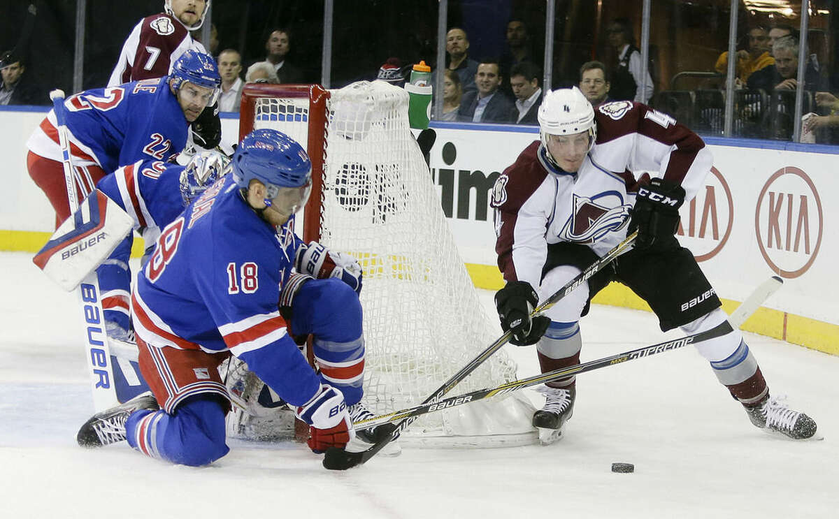 Colorado Avalanche's Tyson Barrie (4) is defended by New York Rangers' Marc Staal during the first period of an NHL hockey game Thursday, Nov. 13, 2014, in New York. (AP Photo/Frank Franklin II)