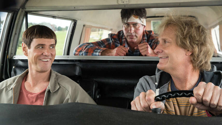 "AP photoThis image released by Universal Pictures shows Jim Carrey, left, Jeff Daniels, right, and Rob Riggle in a scene from ""Dumb and Dumber To."""