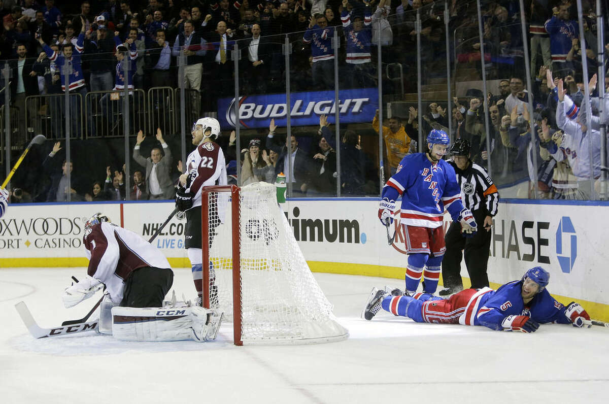 New York Rangers' Mats Zuccarello (36) and Dan Girardi (5) celebrate after Girardi scored a goal as Colorado Avalanche goalie Semyon Varlamov (1), of Russia, reacts, during the second period of an NHL hockey game Thursday, Nov. 13, 2014. (AP Photo/Frank Franklin II)