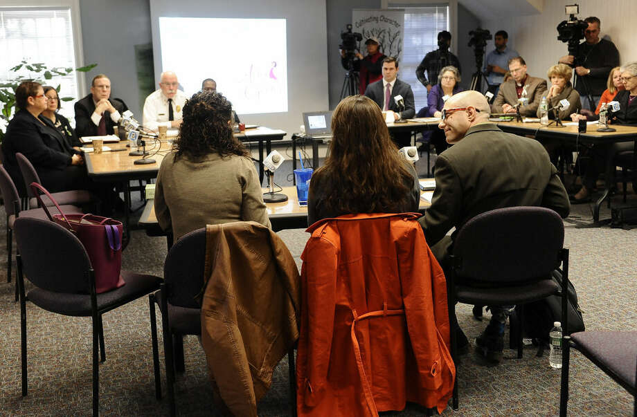 Jeremy Richman, right, and his wife Jennifer Hensel, center, parents of Sandy Hook Elementary school shooting victim Avielle Richman, and Nelba Marquez-Greene, left, mother of victim Ana Marquez-Greene address the Sandy Hook Advisory Commission, Friday, Nov. 14, 2014, in Newtown, Conn. The parents made presentations on ways to better address mental health, school safety and gun violence prevention. (AP Photo/Jessica Hill)