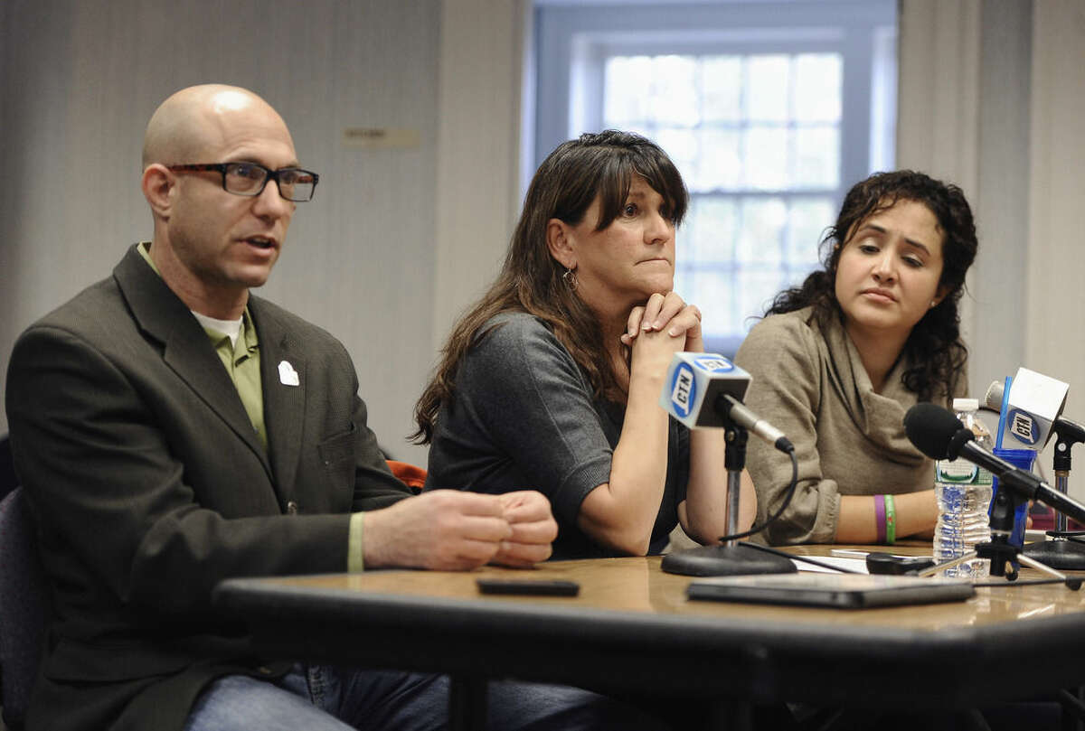 Jeremy Richman, left, and his wife Jennifer Hensel, center, parents of Sandy Hook Elementary school shooting victim Avielle Richman, and Nelba Marquez-Greene, right, mother of victim Ana Marquez-Greene address the Sandy Hook Advisory Commission, Friday, Nov. 14, 2014, in Newtown, Conn. The parents made presentations on ways to better address mental health, school safety and gun violence prevention. (AP Photo/Jessica Hill)