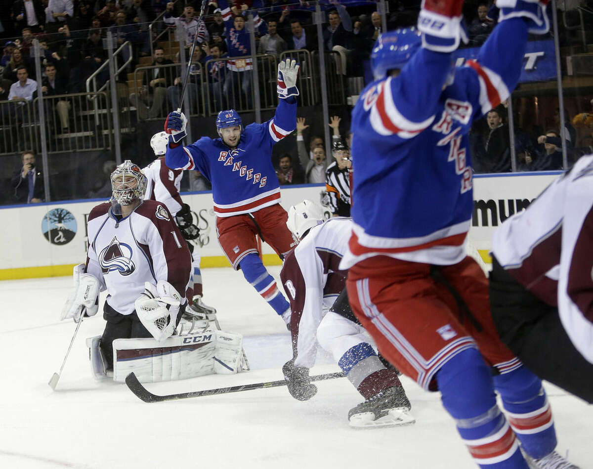 Colorado Avalanche goalie Semyon Varlamov (1), of Russia,reacts as New York Rangers' Rick Nash and Derek Stepan, right, celebrate a goal by Stepan during the second period of an NHL hockey game Thursday, Nov. 13, 2014. (AP Photo/Frank Franklin II)