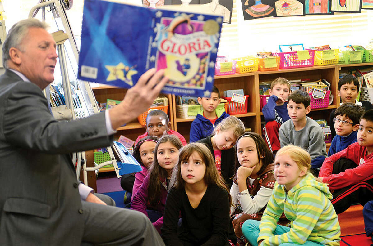 Hour photo / Erik Trautmann Norwalk mayor Harry Rilling reads Officer Buckle and Gloria to Fox Run Elementary School students in Brian Irerra's 3rd grader class Friday as part of the Fox Run Loves to Read event.