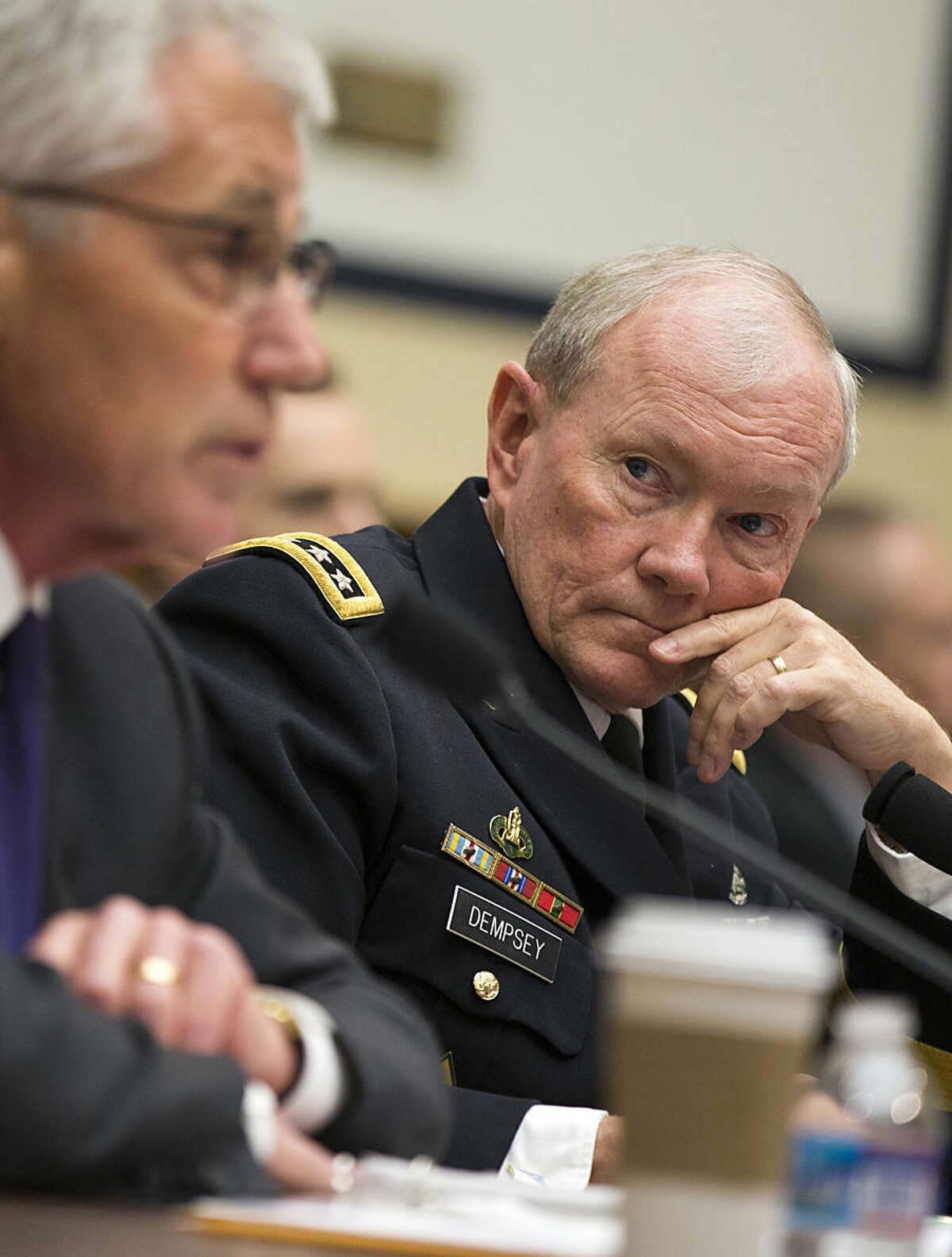 Joint Chiefs Chairman Gen. Martin Dempsey listens, at right, as Defense Secretary Chuck Hagel testifies on Capitol Hill in Washington, Thursday, Nov. 13, 2014, before the House Armed Services committee hearing on the Islamic State group. (AP Photo/Evan Vucci)