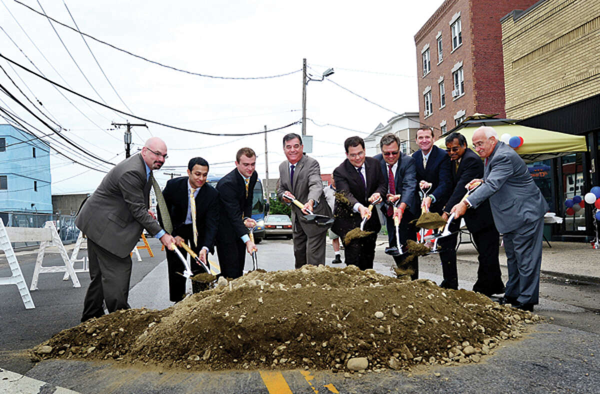 Former Stamford Mayor Michael Pavia, center, and other officials participate in the groundbreaking ceremony for the Stamford Urban Transitway, Phase II.
