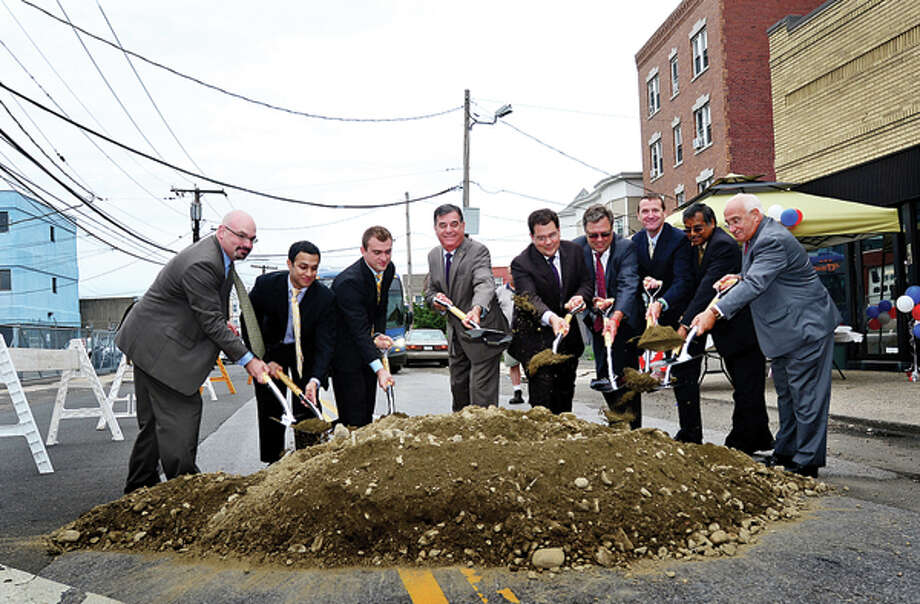 Former Stamford Mayor Michael Pavia, center, and other officials participate in the groundbreaking ceremony for the Stamford Urban Transitway, Phase II. / (C)2013, The Hour Newspapers, all rights reserved