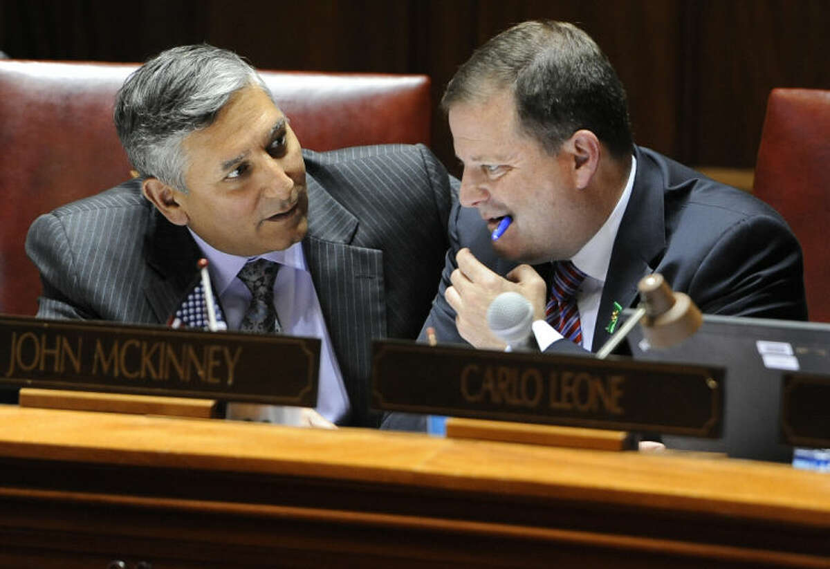 In this file photo, State Sen. Len Fasano, R-North Haven, left, speaks with Senate Minority Leader John McKinnery, R-Fairfield, during the final day of session at the Capitol in Hartford, Conn., Wednesday, June 5, 2013. Lawmakers wrap up a session that was dominated at the beginning and the end by issues related to the shooting at Sandy Hook Elementary School. (AP Photo/Jessica Hill)
