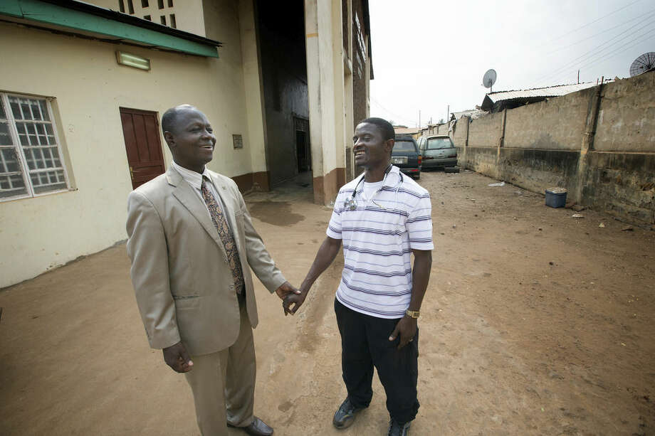 In this April 2014 photo provided by the United Methodist News Service, Dr. Martin Salia, right, visits with Bishop John K. Yambasu at the United Methodist Church's Kissy Hospital outside Freetown, Sierra Leone. Salia has tested positive for Ebola and will be flown, on Saturday, Nov. 15, 2014, to the Nebraska Medical Center, in Omaha, Neb., for treatment. (AP Photo/United Methodist News Service, Mike DuBose) MANDATORY CREDIT