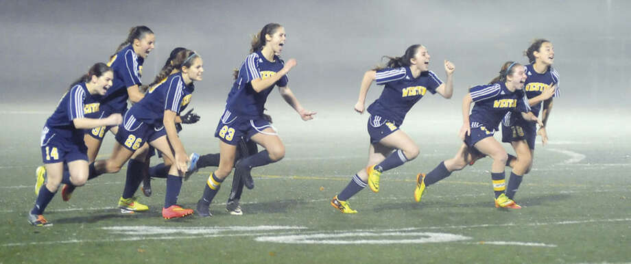 Hour photo/John NashThe Weston girls soccer team raced to celebrate their 2-2 (8-7 PK) win over Suffield in the Class M semifinals. On Saturday, the Trojans get a shot at East Catholic for the state title.