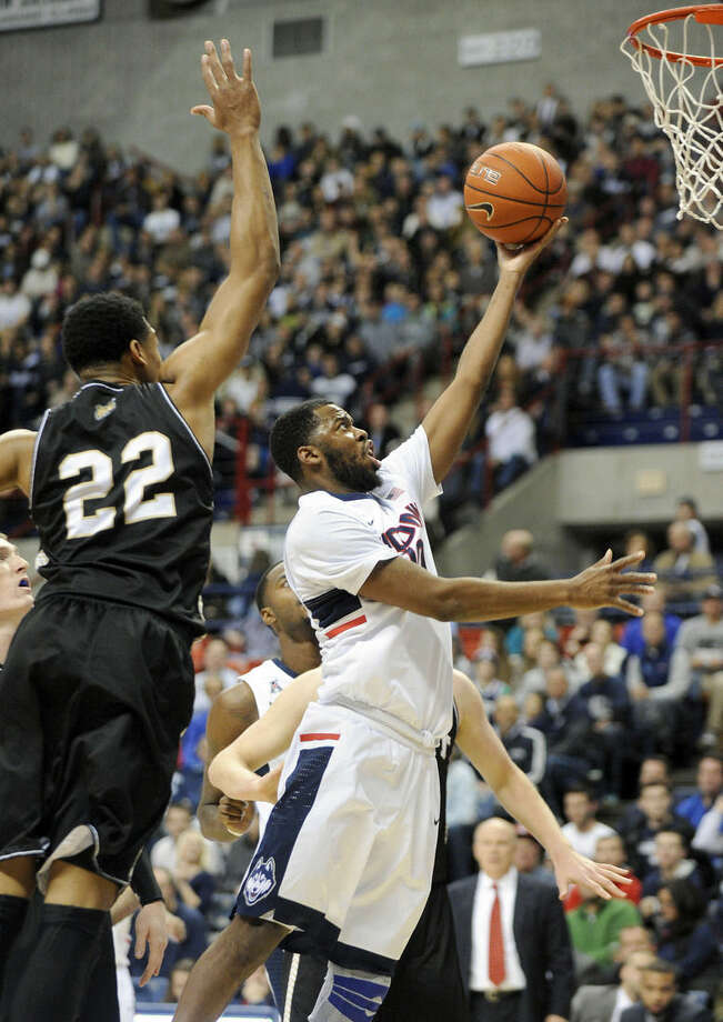 Connecticut's Sam Cassell Jr. (10) drives past Bryant's Dan Garvin (22) during the first half of an NCAA college basketball game in Storrs, Conn., on Friday, Nov. 14, 2014. (AP Photo/Fred Beckham)