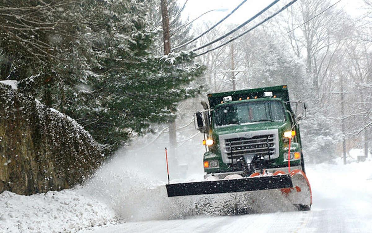 Hour file photo / Erik Trautmann Norwalk DPW plows Richards Ave after a brief snowstorm last winter.