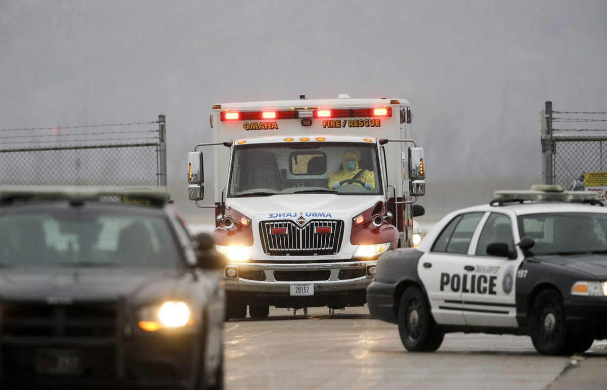 Police vehicles escort the ambulance carrying Dr. Martin Salia, a surgeon working in Sierra Leone who had been diagnosed with Ebola, as it heads from the airport to the Nebraska Medical Center in Omaha, Neb., Saturday, Nov. 15, 2014. Dr. Salia is the third Ebola patient at the Omaha hospital and the 10th person with Ebola to be treated in the U.S. (AP Photo/Nati Harnik)