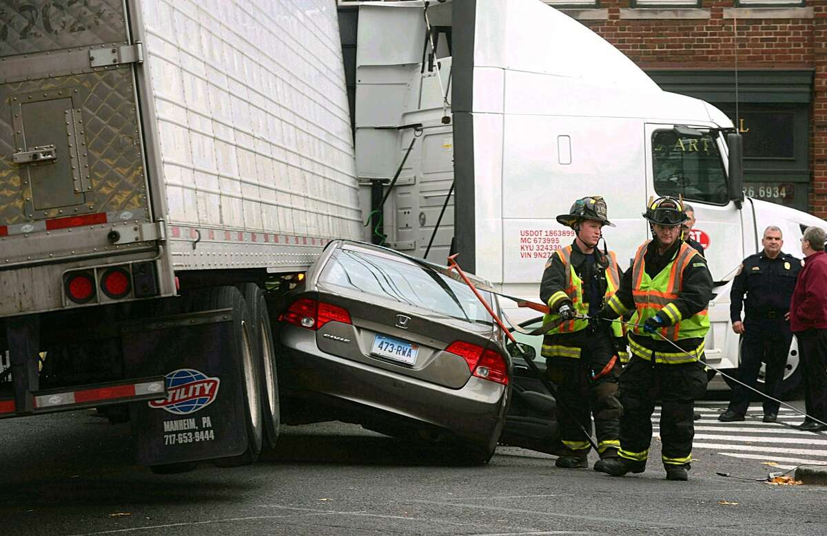 Car gets stuck under tractor trailer on Riverside Avenue in Westport Thursday.