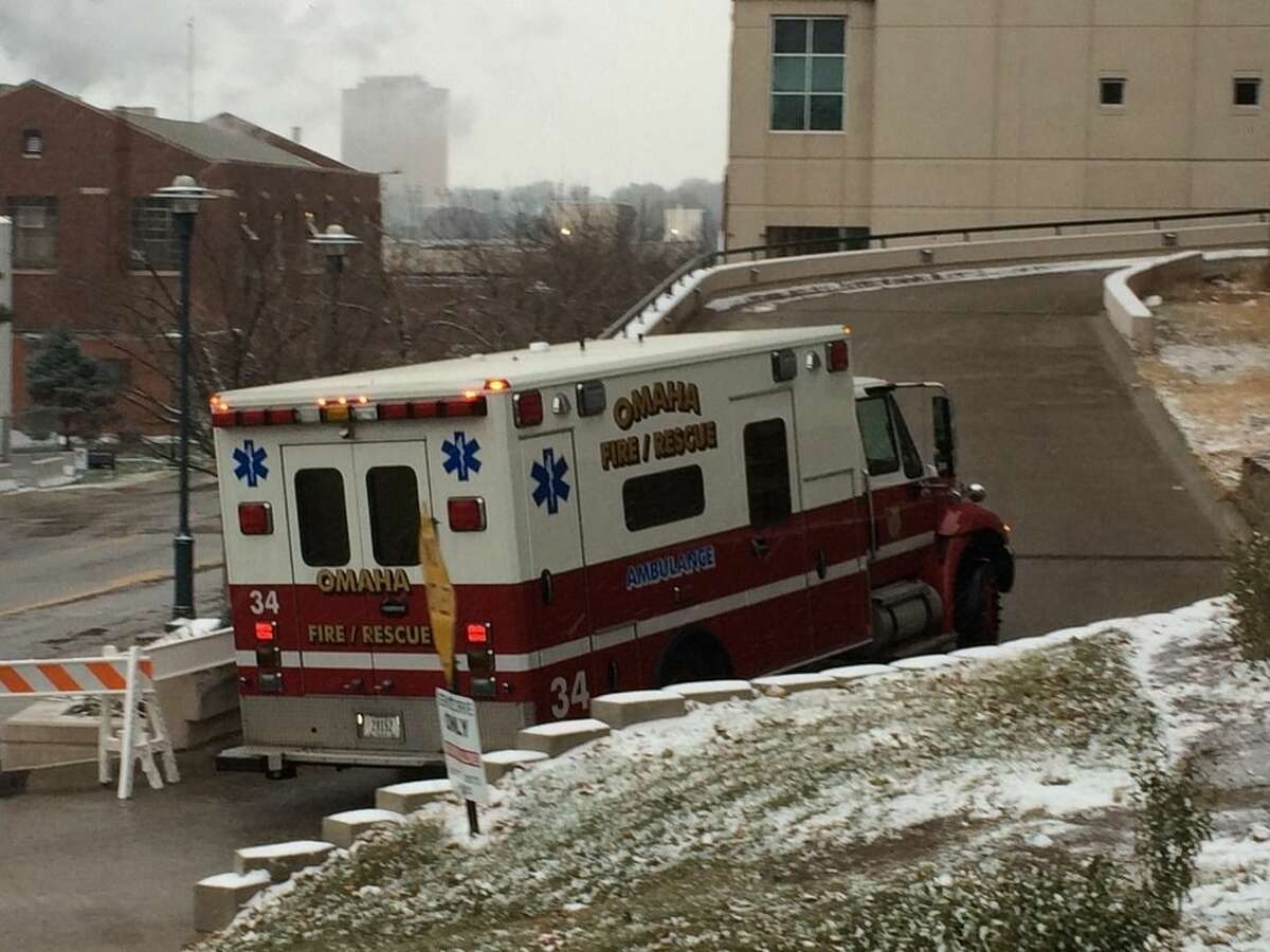 An ambulance carrying Dr. Martin Salia, a surgeon working in Sierra Leone who had been diagnosed with Ebola, drives to the Nebraska Medical Center in Omaha, Neb., Saturday, Nov. 15, 2014. Dr. Salia is the third Ebola patient at the Omaha hospital and the 10th person with Ebola to be treated in the U.S. (AP Photo/Margery A. Beck)