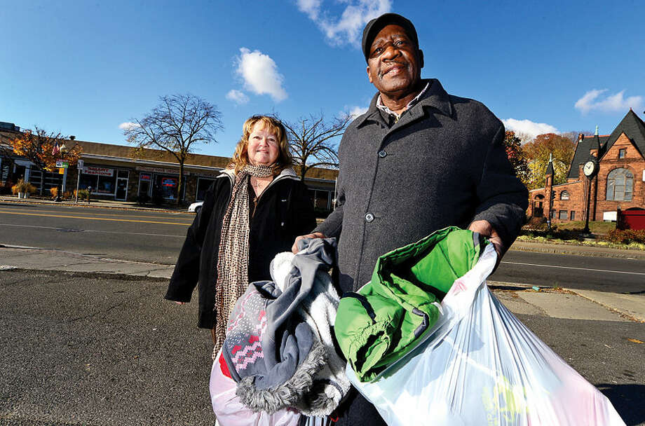 Hour photo / Erik Trautmann Ernie Dumas is collecting coats with the help of Lyn Detroy for his yearly coat giveaway at Thanksgiving.
