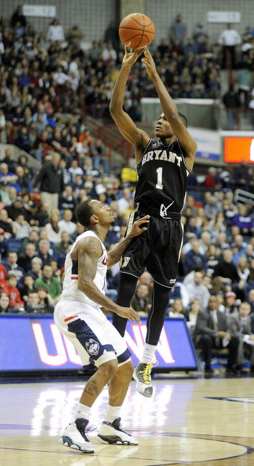 Bryant's Hunter Ware (1) shoots over Connecticut's Ryan Boatright (11) during the first half of an NCAA college basketball game in Storrs, Conn., on Friday, Nov. 14, 2014. (AP Photo/Fred Beckham)
