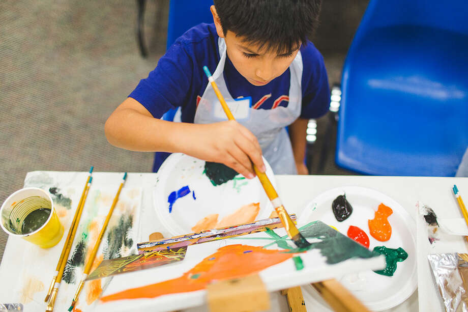 Neil Alvarado, 9, a third grader at Cranbury Elementary School puts his artistic skills to use at the Kids and Canvas Paint Party sponsored by The Hour Newspaper for children age nine through twelve at the Norwalk Public Library Friday evening. DAVID ESPOSITO / Hour Photo