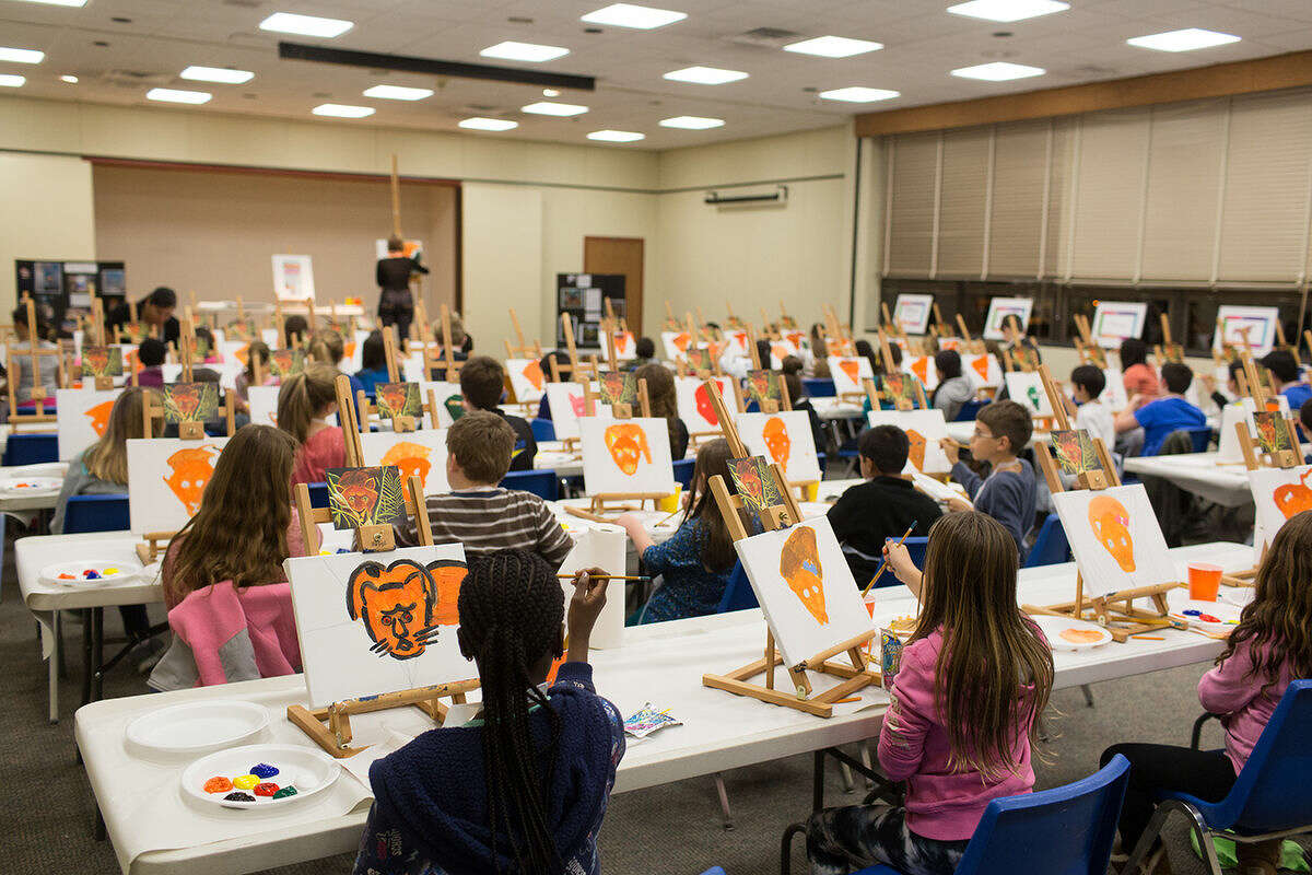 Children ages nine through twelve gathered for fun, pizza and painting at the Kids and Canvas Paint Party sponsored by The Hour Newspaper, Friday evening at the Norwalk Public Library. DAVID ESPOSITO / Hour Photo