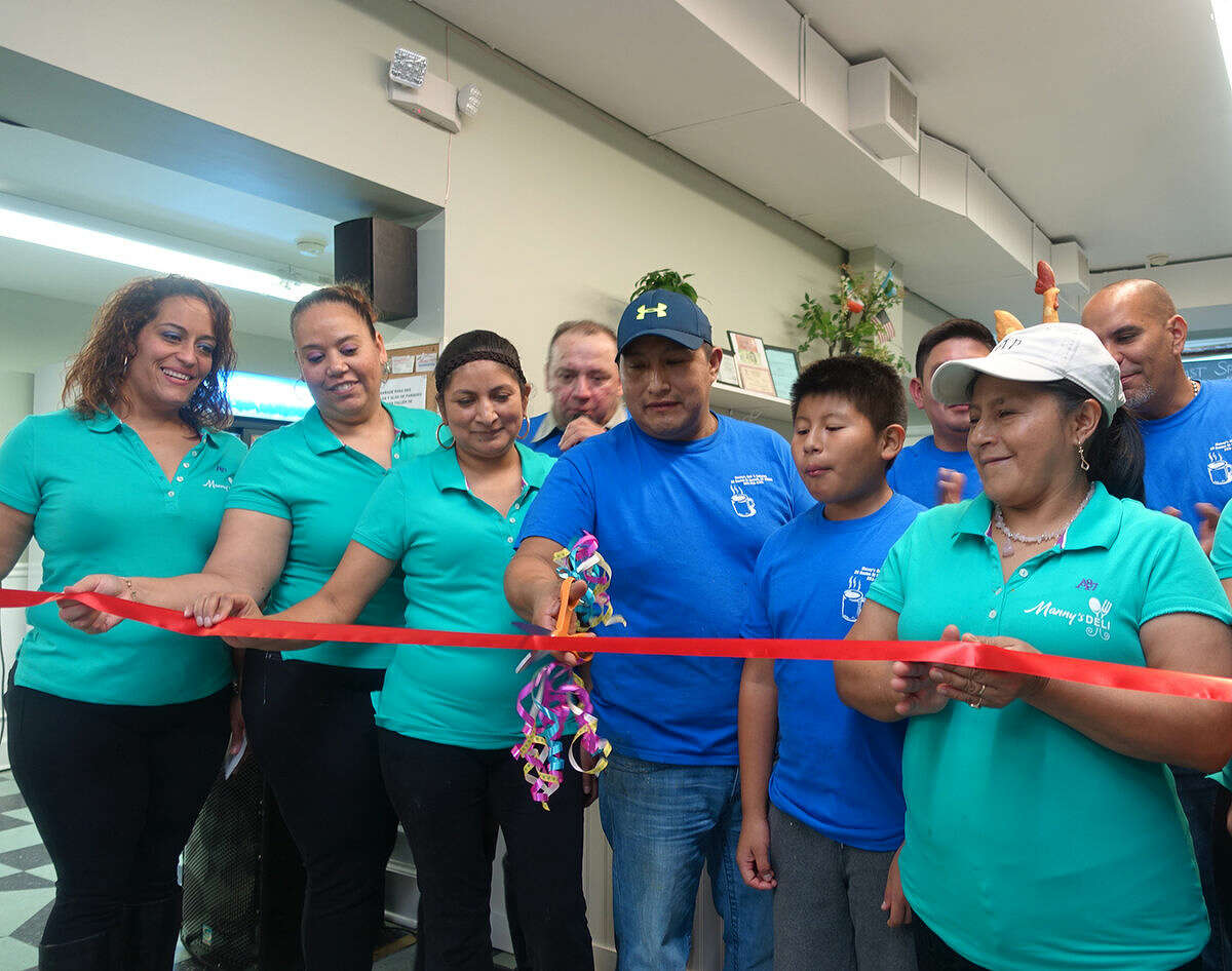 Hour photo/Jeff Dale Manny's Deli holds a ribbon cutting Saturday night the new spanish restaurant at 28 Bouton St. Norwalk.