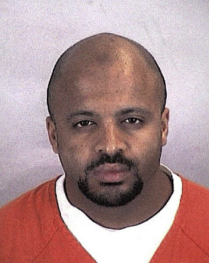 FILE - In this undated file photo provided by the Sherburne County Sheriff Office, Zacarias Moussaoui is shown. Claiming that he can offer inside information about al-Qaida that could support claims against Saudi Arabia and financial institutions, Moussaoui says he wants to testify in lawsuits filed by victims of terrorism. Some lawyers have taken him seriously enough to interview him at a maximum-security prison in southern Colorado. But others have questioned his motives. (AP Photo/Sherburne County, Minn., Sheriff's Office, File)