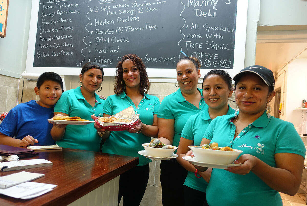 Hour photo/Jeff Dale Wait staff at Manny's Deli, 28 Bouton St., show off some of the food offered at the newest Norwalk eatery.