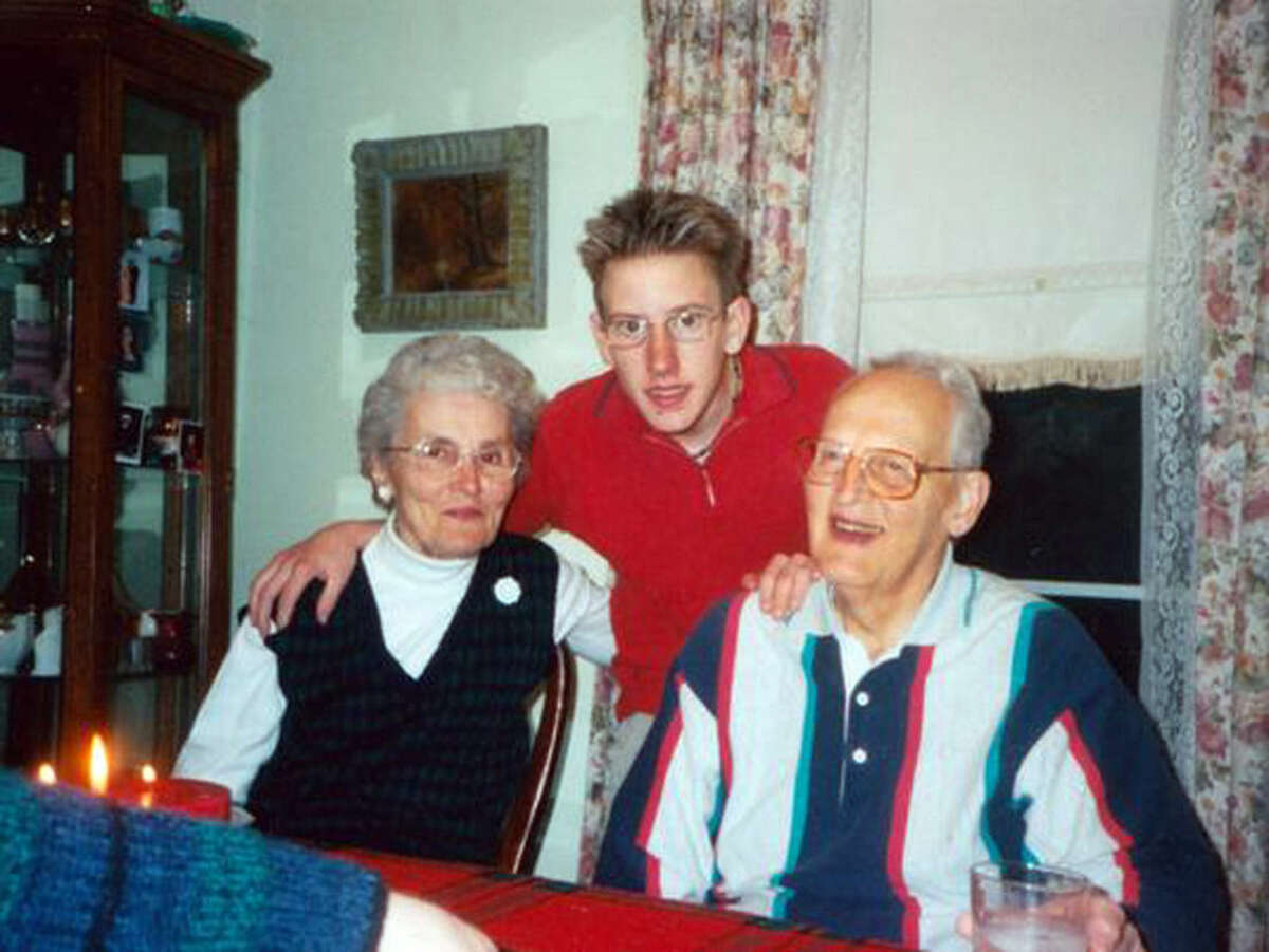 In this undated photo provided by the Kassig family, Peter Kassig, is shown with his maternal grandparents. His grandfather, a co-founder of Christians for Peace and Justice in the Middle East, was an advocate for Palestinians in their struggle for a homeland. The Islamic State group released a graphic video on Sunday, Nov. 16, 2014, in which a black-clad militant claimed to have beheaded U.S. aid worker Peter Kassig, who was providing medical aid to Syrians fleeing the civil war when he was captured inside Syria on Oct. 1, 2013. His friends say he converted to Islam in captivity and took the first name Abdul-Rahman. (AP Photo/Courtesy Kassig Family)