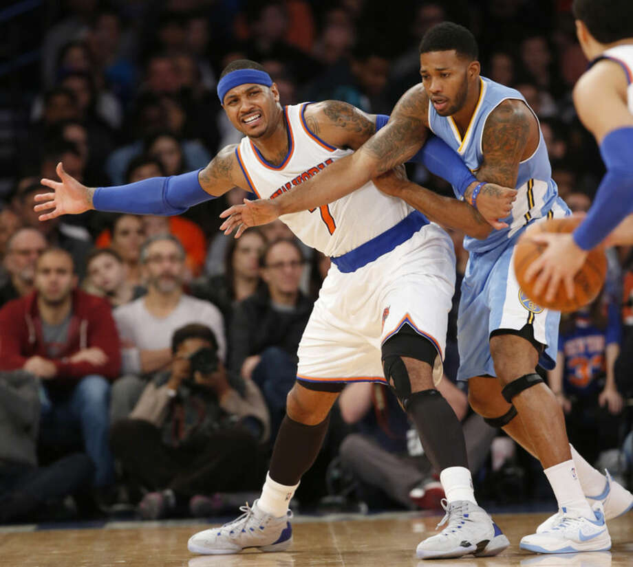 New York Knicks forward Carmelo Anthony (7) calls for the ball from Knicks guard Pablo Prigioni, right, as Denver Nuggets forward Alonzo Gee, center, defends in the first half of an NBA basketball game in New York, Sunday, Nov. 16, 2014. (AP Photo/Kathy Willens)