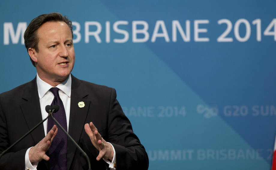 British Prime Minister David Cameron addresses a press conference at the conclusion of the G-20 summit in Brisbane, Australia, Sunday, Nov. 16, 2014. (AP Photo/Mark Baker)
