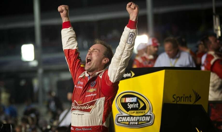 Kevin Harvick celebrates winning the NASCAR Sprint Cup championship series auto race, Sunday, Nov. 16,2014 in Homestead, Fla. (AP Photo/J Pat Carter)