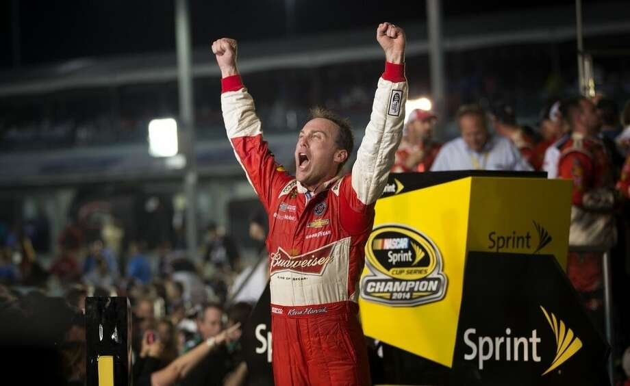 Kevin Harvick celebrates after winning the NASCAR Sprint Cup championship series auto race, Sunday, Nov. 16, 2014, in Homestead, Fla. (AP Photo/J Pat Carter)