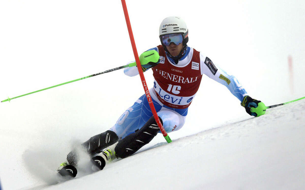 Ted Ligety competes during the first run of an alpine ski, men's World Cup slalom race, in Levi, Finland, Sunday, Nov. 16, 2014. (AP Photo/Shinichiro Tanaka)
