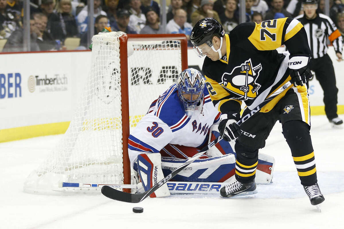 New York Rangers goalie Henrik Lundqvist (30) stops a shot by Pittsburgh Penguins' Patric Hornqvist (72) in the second period of an NHL hockey game, Saturday, Nov. 15, 2014, in Pittsburgh. (AP Photo/Keith Srakocic)