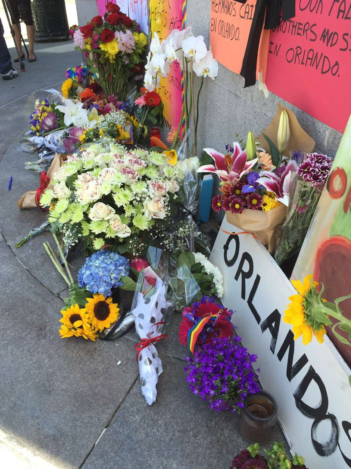 Dozens of flowers at a memorial at 18th and Castro streets. #OrlandoNightclubShooting