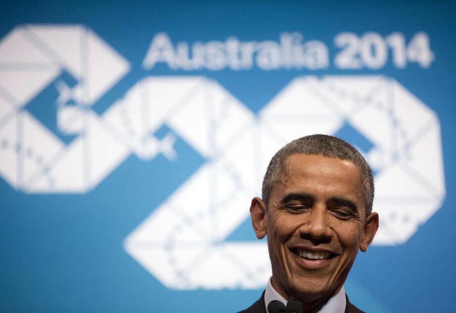U.S. President Barack Obama speaks during his news conference at the G20 Summit in Brisbane, Australia, Sunday, Nov. 16, 2014. (AP Photo/Pablo Martinez Monsivais)
