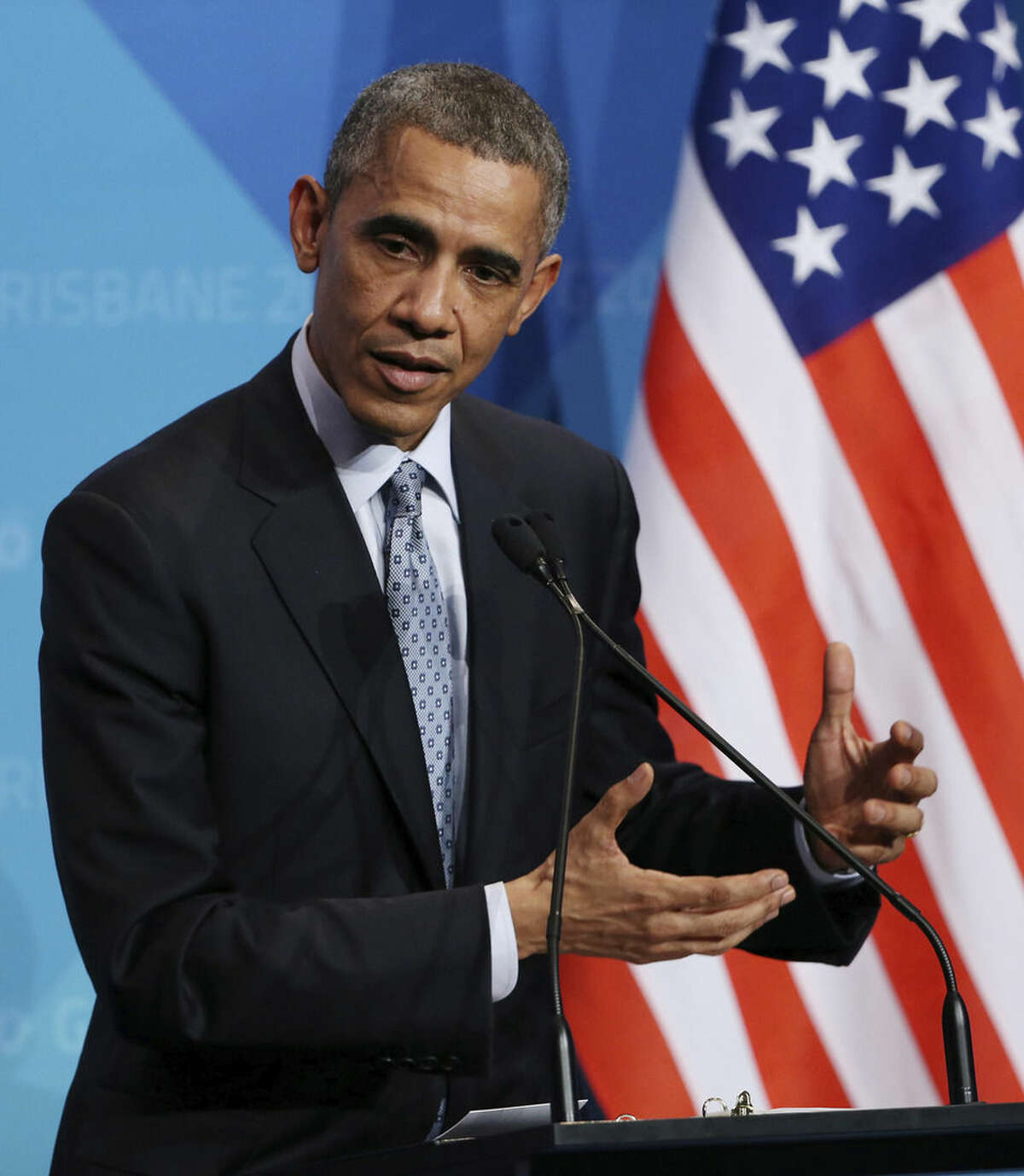 U.S. President Barak Obama gestures as he answers a question from the media during a press conference at the conclusion of the G-20 summit in Brisbane, Australia, Sunday, Nov. 16, 2014.(AP Photo/Rob Griffith)