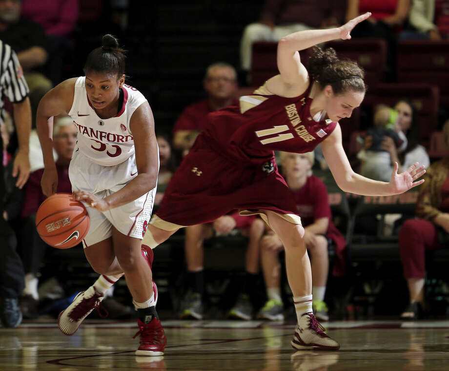 Stanford guard Amber Orrange dribbles past Boston College guard Nicole Boudreau (11) during the second half of an NCAA college basketball game Friday, Nov. 14, 2014, in Stanford, Calif. (AP Photo/Marcio Jose Sanchez)