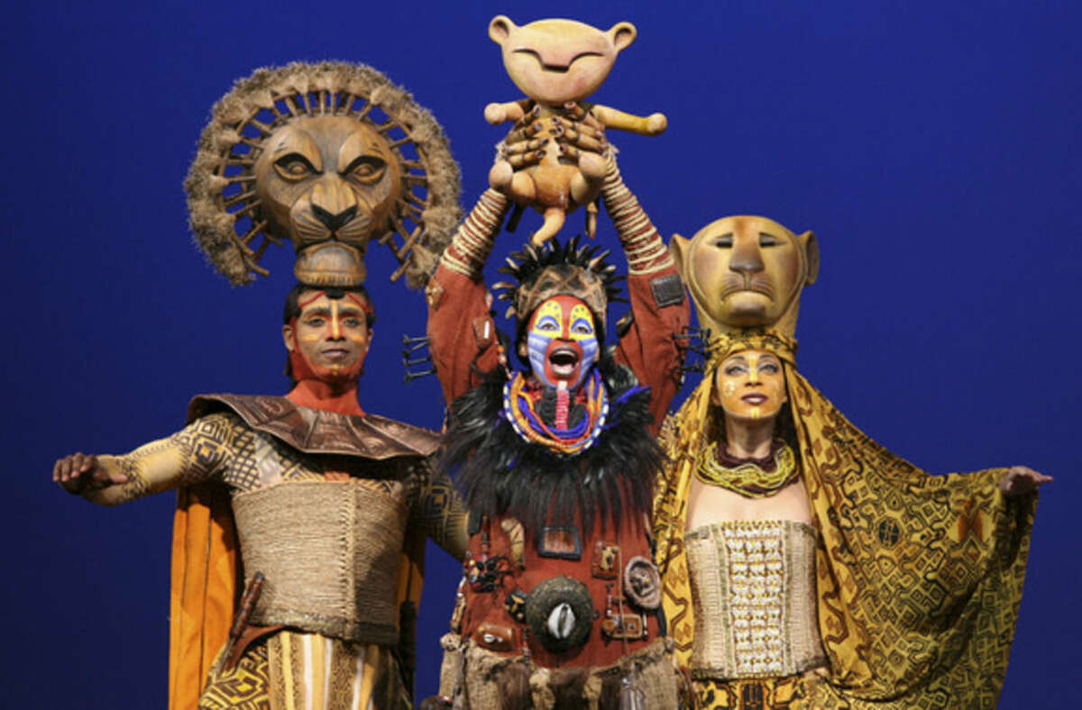 FILE - This file photo released by the Disney Theatrical Group shows, from left, Nathaniel Stampley as Mufasa, Tshidi Manye as Rafiki, and Jean Michelle Grier as Sarabi, in Disney's