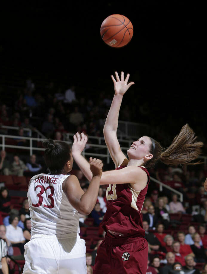 Boston College's Kelly Hughes, right, shoots over Stanford's Amber Orrange (33) during the first half of an NCAA college basketball game Friday, Nov. 14, 2014, in Stanford, Calif. (AP Photo/Marcio Jose Sanchez)