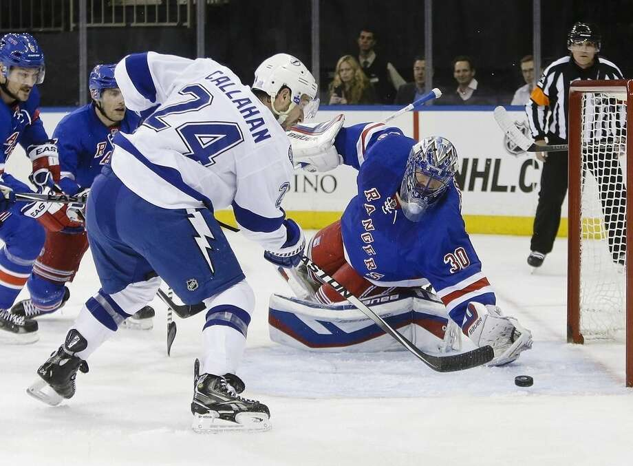 Tampa Bay Lightning's Ryan Callahan (24) shoots the puck past New York Rangers' Henrik Lundqvist (30), of Sweden, during the first period of an NHL hockey game Monday, Nov. 17, 2014, in New York. (AP Photo/Frank Franklin II)