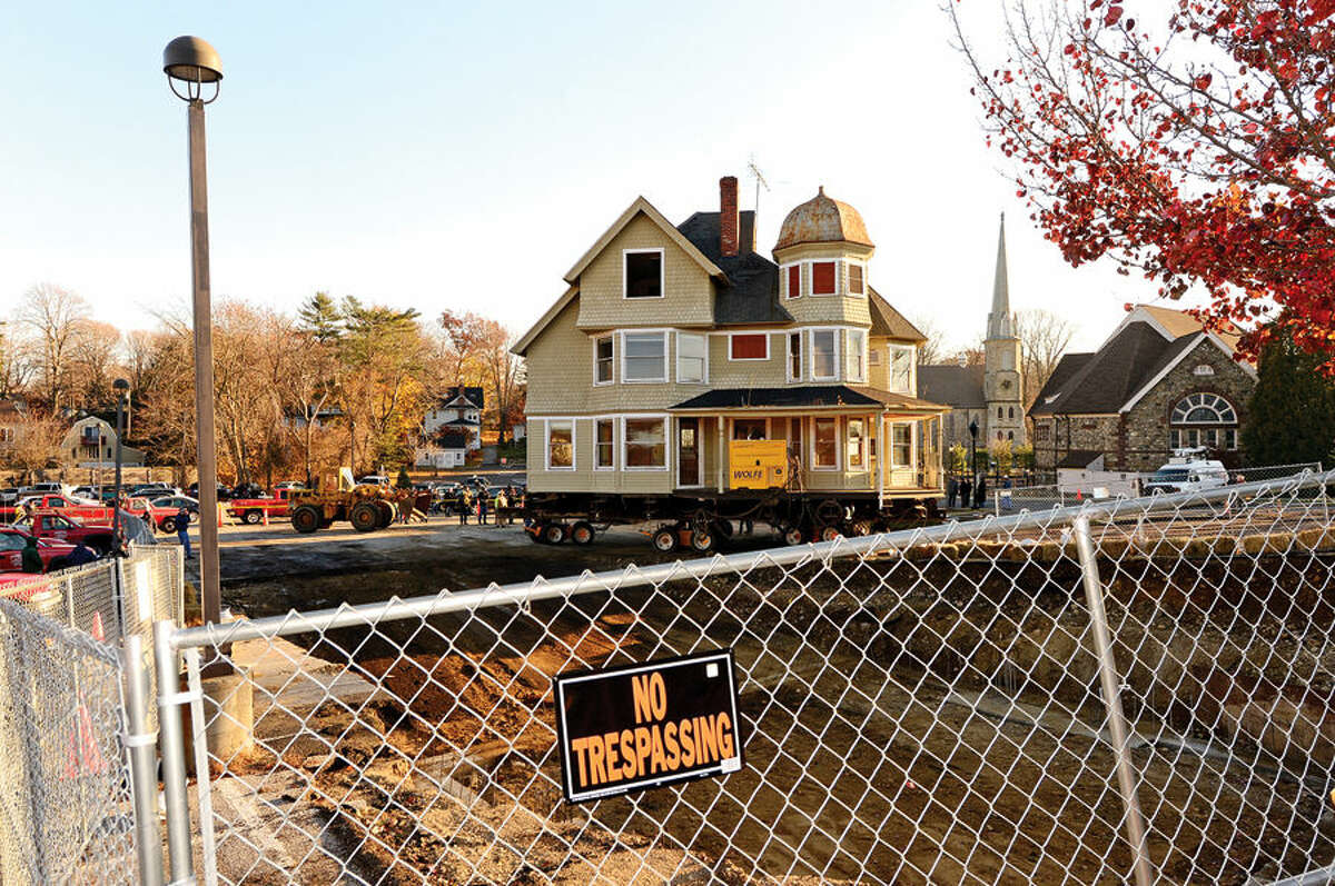 Hour photo / Erik Trautmann Westport's historic Kemper Gunn house is relocated from 35 Church St across the street to the Baldwin parking lot early Tuesday morning.