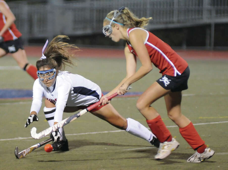 Hour photo/John NashBrien McMahon's Natalie Leslie, left, looks to defend New Canaan's Bridget Falcone as she tries to push the ball up field during Tuesday's FCIAC field hockey game at Casagrande Field in Norwalk. New Canaan claimed a 2-0 victory over the Senators.