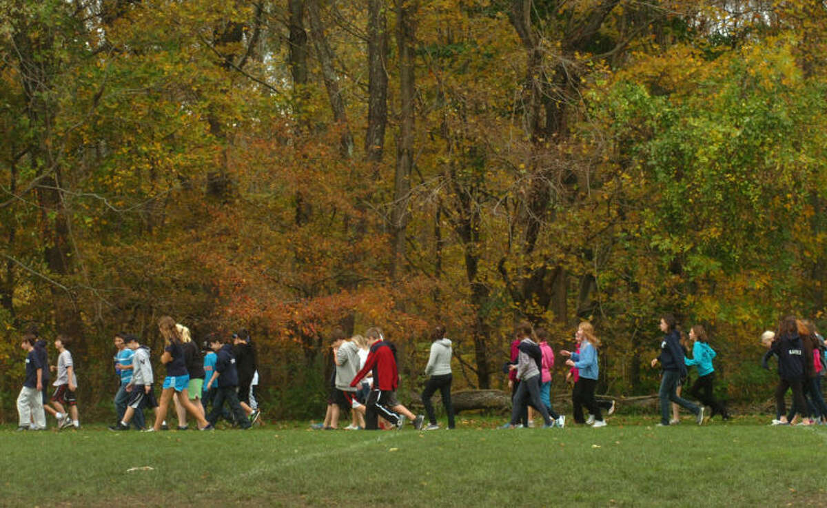 In this October 2011 file photo, students at Middlebrook School walk the athletic field during the school's annual charity. Three local sports teams are seeking to raise $800,000 to convert Middlebrook School's athletic field from grass to turf and install new lighting in a private financing campaign.
